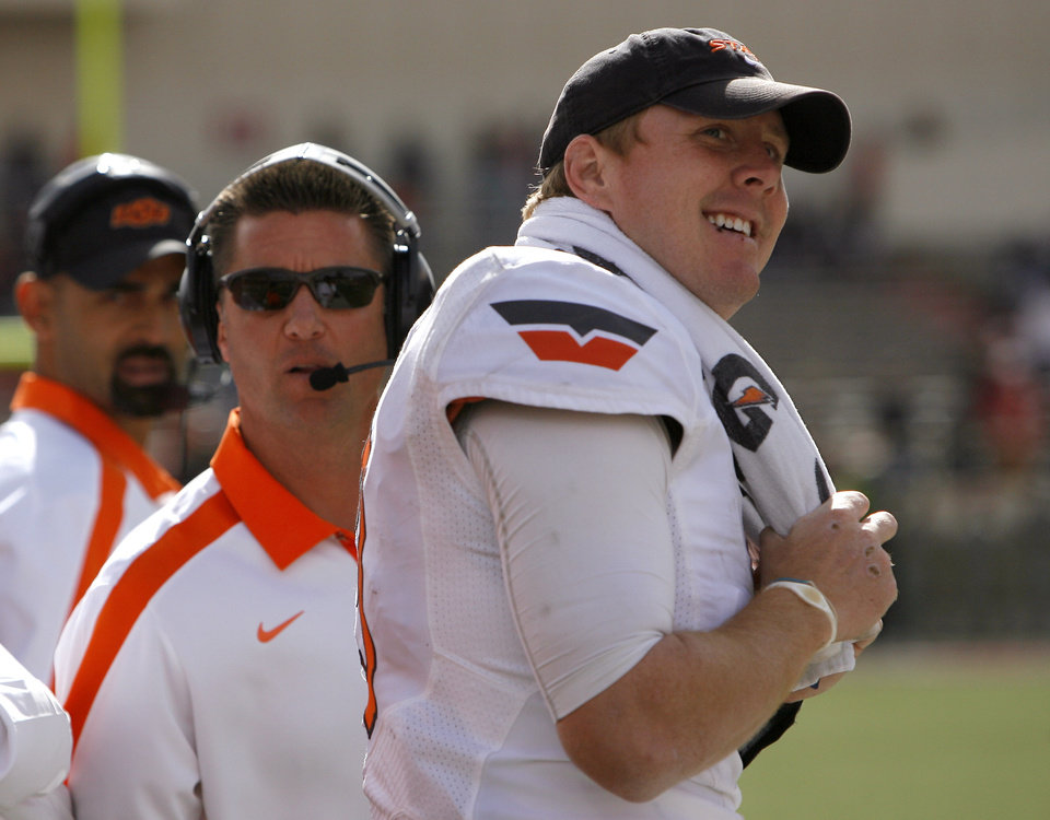 Photo - Oklahoma State's Brandon Weeden (3) looks at the crowd duringa a college  football game between Texas Tech University (TTU) and Oklahoma State University (OSU) at Jones AT&T Stadium in Lubbock, Texas, Saturday, Nov. 12, 2011.  Photo by Sarah Phipps, The Oklahoman  ORG XMIT: KOD