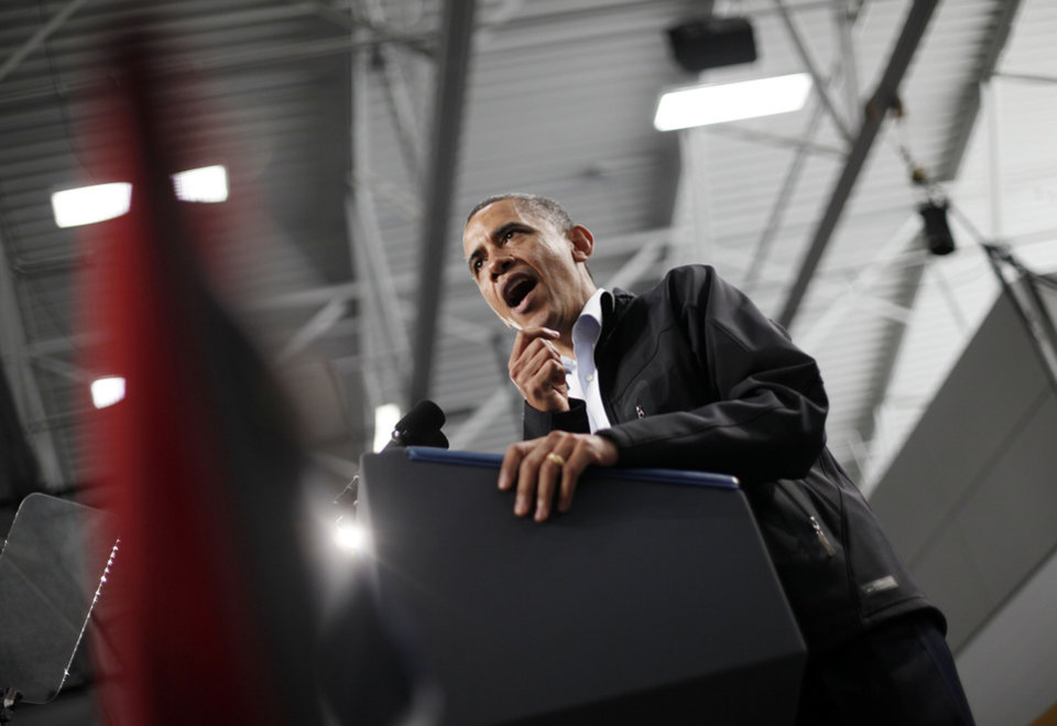 Photo -   President Barack Obama gestures while speaking to supporters at Springfield High School during a campaign event, Friday, Nov. 2, 2012, in Springfield, Ohio. (AP Photo/Pablo Martinez Monsivais)