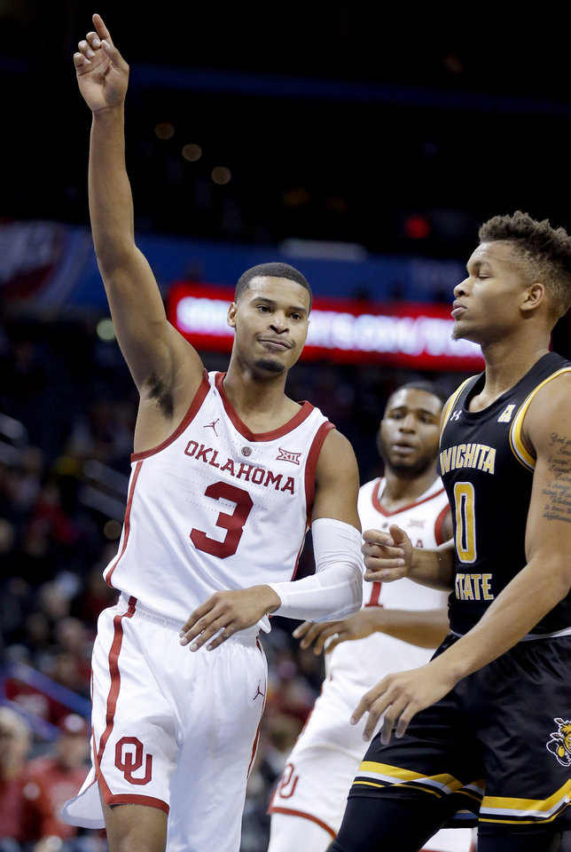 Photo - Oklahoma's Miles Reynolds (3) celebrates next to Wichita State's Dexter Dennis (0)  during the college basketball game between the University of Oklahoma and Wichita State at the Chesapeake Energy Arena during the All-College Basketball Classic,  Saturday, Dec. 8, 2018. Photo by Sarah Phipps, The Oklahoman