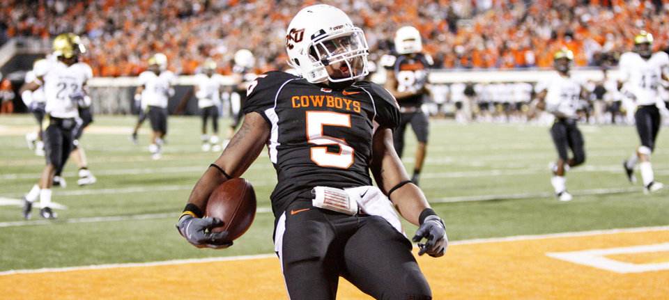 Oklahoma State running back Keith Toston scores a touchdown in the third quarter. Toston rushed for 172 yards and a touchdown. Photo by Bryan Terry, The Oklahoman
