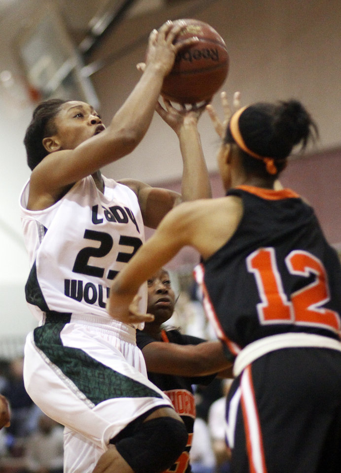 Edmond Santa Fe's Courtney Walker (23) moves to the hoop as Kaylan Mayberry (12) of Booker T. Washington defends during a girls high school basketball game between Edmond Santa Fe and Booker T. Washington from Tulsa in the 2011 Edmond Open Basketball Tournament at Edmond Memorial High School in Edmond, Okla., Friday, Dec. 9, 2011. Photo by Nate Billings, The Oklahoman