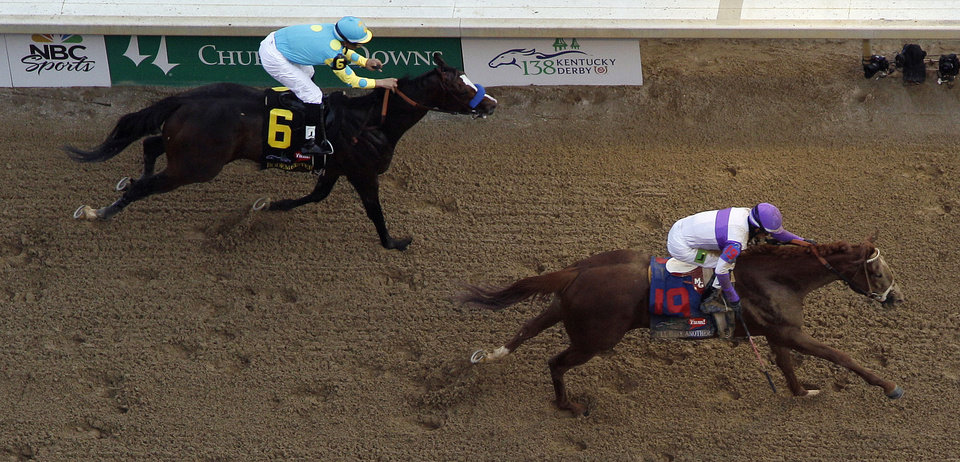Jockey Mario Gutierrez rides I\'ll Have Another past Bodemeister ridden by Mike Smith (6) to victory in the 138th Kentucky Derby horse race at Churchill Downs Saturday, May 5, 2012, in Louisville, Ky. (AP Photo/Charlie Riedel) ORG XMIT: DBY209