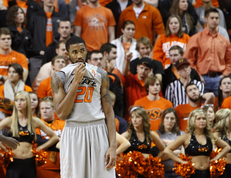 Photo - Oklahoma State's Michael Cobbins (20) reacts during an NCAA college basketball game between the Oklahoma State University Cowboys (OSU) and the Kansas State University Wildcats (KSU) at Gallagher-Iba Arena in Stillwater, Okla., Saturday, Jan. 21, 2012. Photo by Bryan Terry, The Oklahoman