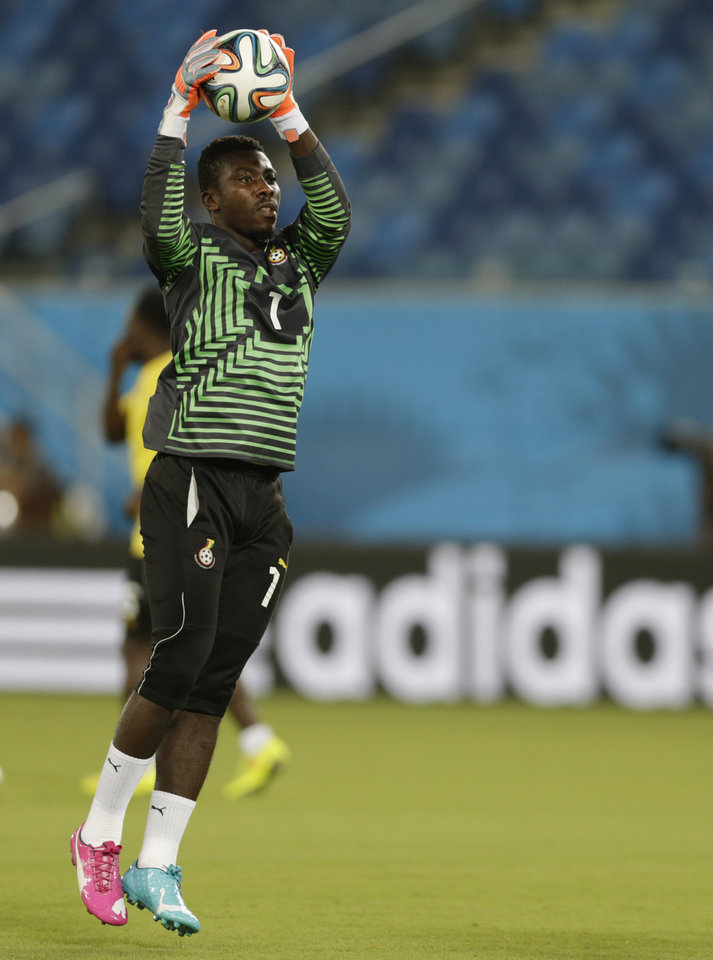 Photo - Ghana goalkeeper Stephen Adams works out during an official training session the day before the group G World Cup soccer match between Ghana and the United States at the Arena das Dunas in Natal, Brazil, Sunday, June 15, 2014. (AP Photo/Dolores Ochoa)
