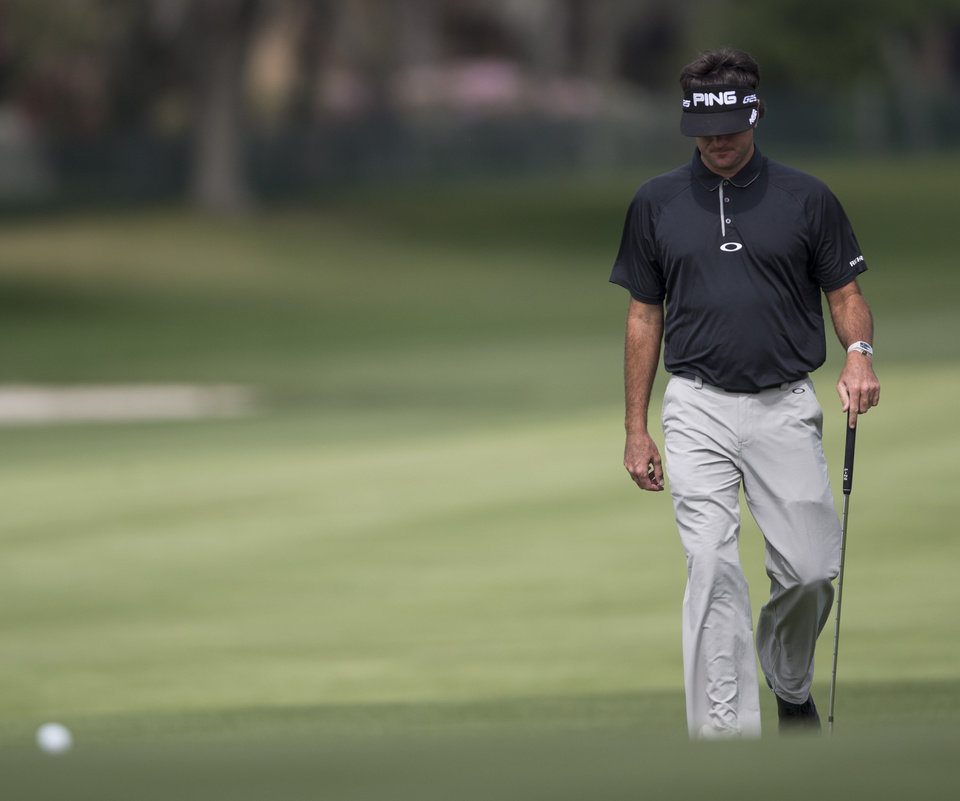 Photo - Bubba Watson walks up the fairway on the fifth hole during the first round of the Arnold Palmer Invitational golf tournament at Bay Hill Thursday March 20, 2014, in Orlando, Fla. (AP Photo/ Willie J. Allen Jr.)