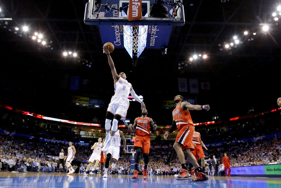 Photo - Oklahoma City's Russell Westbrook (0) shoots a lay up during the NBA basketball game between the Oklahoma City Thunder and the Portland Trail Blazers at the Chesapeake Energy Arena in Oklahoma City, Sunday, March, 24, 2013. Photo by Sarah Phipps, The Oklahoman