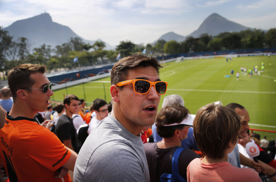 Photo - Fans of the Netherlands soccer team dressed in orange watch from the stands during a training session in Rio de Janeiro, Brazil, Saturday, June 7, 2014. The Netherlands had their first training session open to fans at the Brazilian club Flamengo training complex. The Netherlands plays in group B of the 2014 soccer World Cup. (AP Photo/Wong Maye-E)
