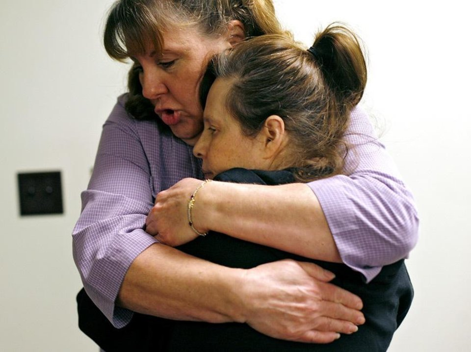 Debbie Scott, an employee at Daily Living Centers, gets a hug from Dana Harris, a client, as Scott greets her at the door in the morning at Daily Living Centers' north Rockwell location in Bethany on Tuesday, Nov. 24, 2009. By John Clanton, The Oklahoman