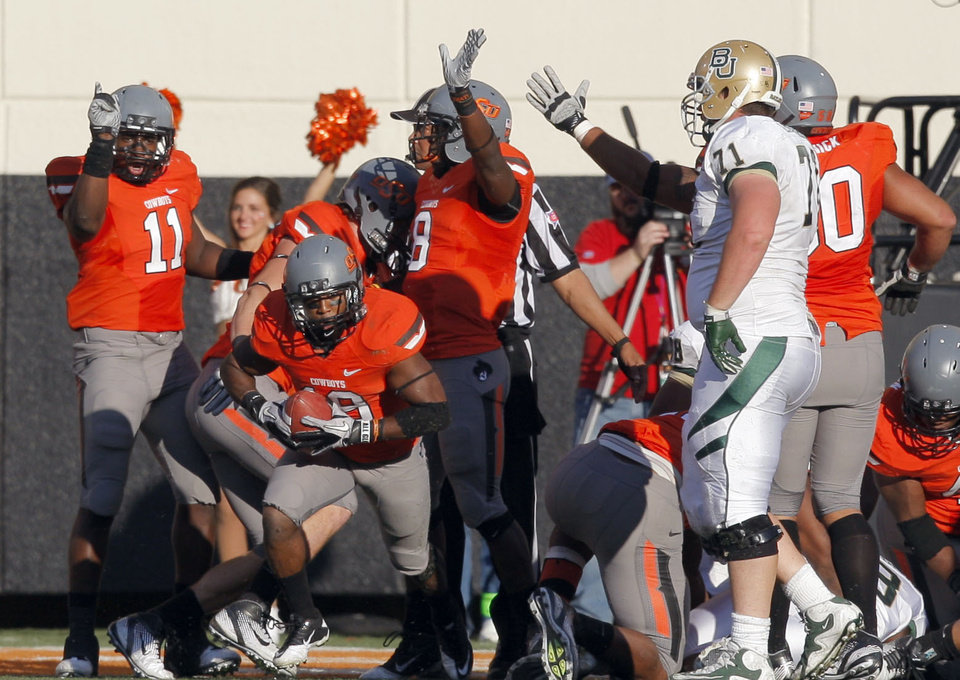 Photo - Oklahoma State celebrates a fumble recovery during a college football game between the Oklahoma State University Cowboys (OSU) and the Baylor University Bears (BU) at Boone Pickens Stadium in Stillwater, Okla., Saturday, Oct. 29, 2011. Photo by Sarah Phipps, The Oklahoman