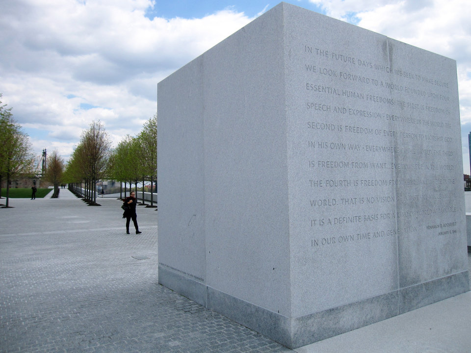 """Photo - This May 1, 2014 photo shows a monument at Franklin D. Roosevelt Four Freedoms Park, located on Roosevelt Island in New York City. The stone bears an excerpt from President Roosevelt's """"Four Freedoms"""" speech, delivered Jan. 6, 1941, declaring freedom of speech, freedom of worship, freedom from want and freedom from fear to be """"essential human freedoms ... attainable in our own time."""" The park, designed by renowned architect Louis I. Kahn, is considered an architectural masterpiece and offers scenic views of the city. (AP Photo/Beth J. Harpaz)"""