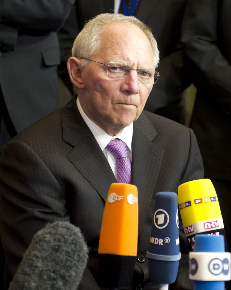 Photo - German Finance Minister Wolfgang Schaeuble speaks with the media during an emergency eurogroup meeting in Brussels on Sunday, March 24, 2013. The EU says a top official will chair a high-level meeting on Cyprus in a last-ditch effort to seal a deal before finance ministers decide whether the island nation gets a 10 billion euro bailout loan to save it from bankruptcy. (AP Photo/Geert Vanden Wijngaert)