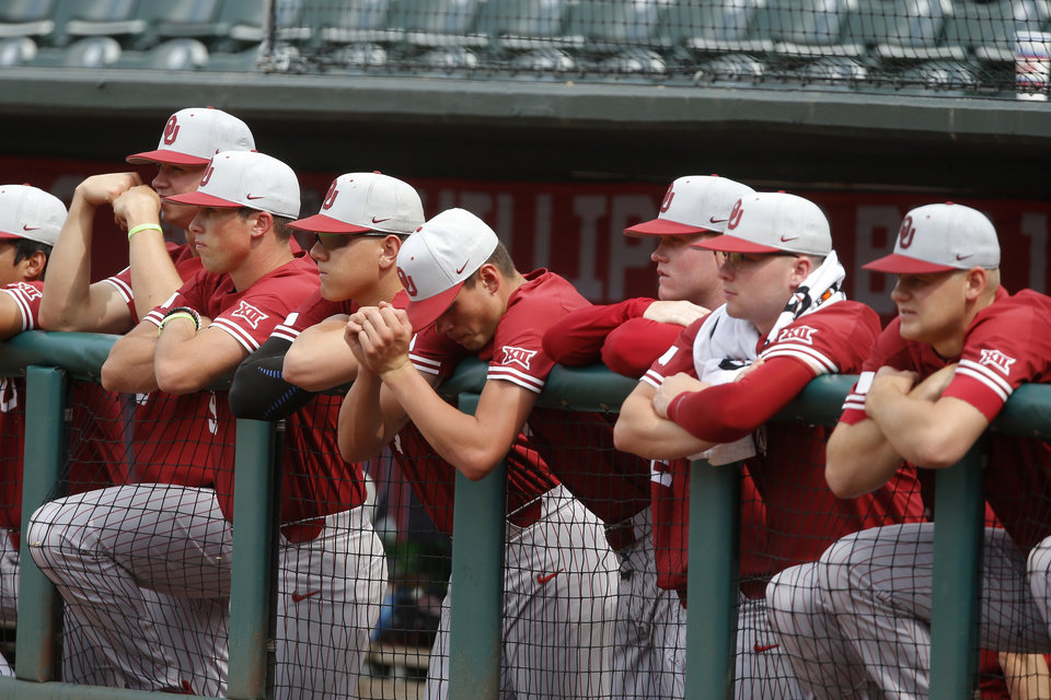 Photo - Oklahoma players stand in the dugout during a Big 12 baseball tournament game between the University of Oklahoma (OU) and TCU at Chickasaw Bricktown Ballpark in Oklahoma City, Okla., Thursday, May 23, 2019.  [Bryan Terry/The Oklahoman]