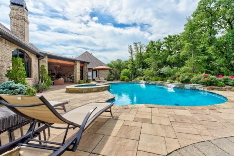 Photo -  Pool and back of the Listing of the Week, 6800 Cave Creek Point in Edmond. [PHOTO PROVIDED]