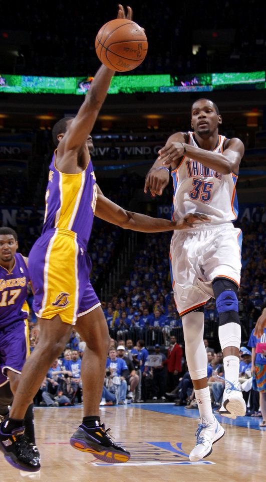 Oklahoma City\'s Kevin Durant (35) passes the ball around Los Angeles\' Metta World Peace (15) during Game 1 in the second round of the NBA playoffs between the Oklahoma City Thunder and L.A. Lakers at Chesapeake Energy Arena in Oklahoma City, Monday, May 14, 2012. Oklahoma City won 119-90. Photo by Bryan Terry, The Oklahoman