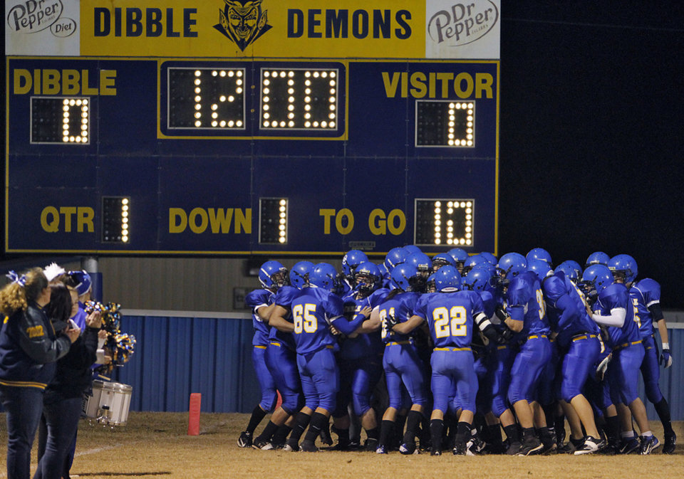 Photo - Dibble prepares to take the field during the high school football playoff game between Dibble High School and Hominy High School at Dibble High School on Friday, Nov. 18, 2011. in Dibble, Okla.  Photo by Chris Landsberger, The Oklahoman