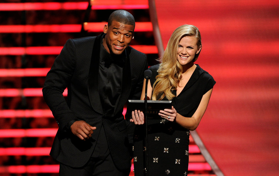 Photo - Carolina Panthers' Cam Newton, left, and model Brooklyn Decker speak on stage at the thirrd annual NFL Honors at Radio City Music Hall on Saturday, Feb. 1, 2014, in New York. (Photo by Evan Agostini/Invision for NFL/AP Images)