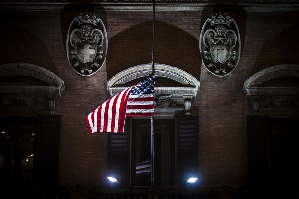 Photo - The American flag flies at half staff to mourn the victims of the Connecticut school shooting, at the US Embassy in Rome, Saturday, Dec. 15, 2012. Police said Saturday they had found