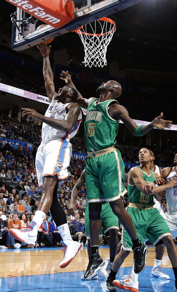Oklahoma City's Kendrick Perkins (5) shoots a lay up as Boston's Kevin Garnett (5) defends during the NBA game between the Oklahoma City Thunder and the Boston Celtics at the Chesapeake Energy Arena in Oklahoma City, Sunday, March 10, 2013. Photo by Sarah Phipps, The Oklahoman
