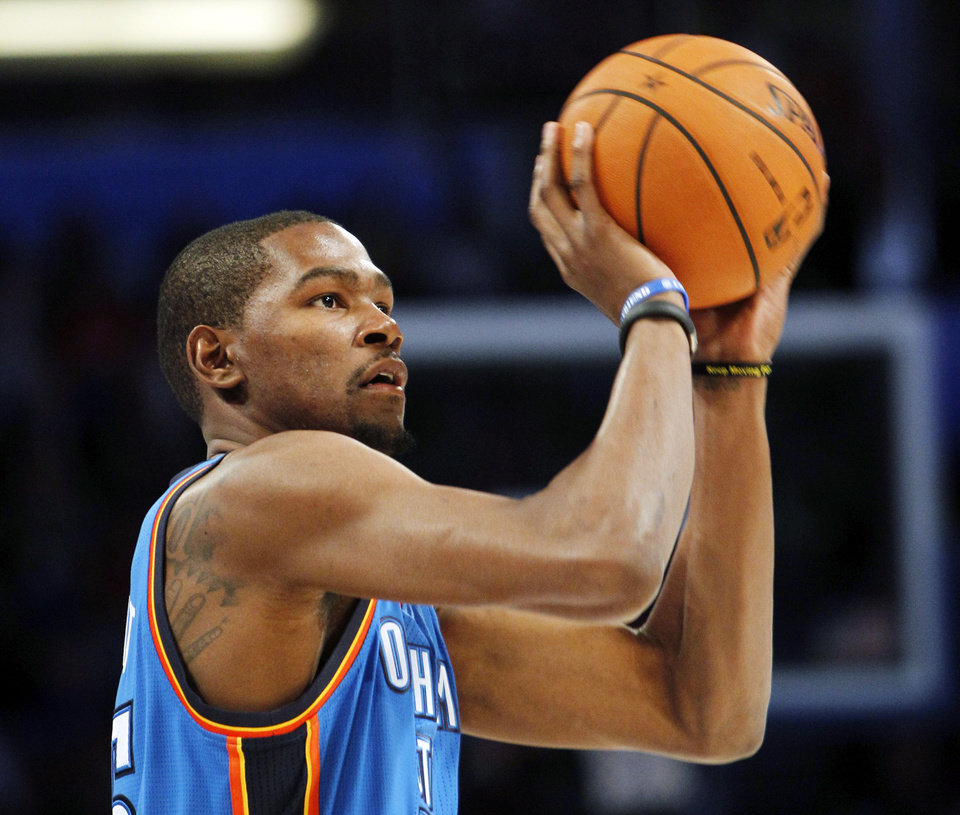 Photo - Oklahoma City Thunder's Kevin Durant shoots during the NBA All-Star Three-Point Shootout basketball competition in Orlando, Fla., Saturday, Feb. 25, 2012. (AP Photo/Lynne Sladky) ORG XMIT: DOA127
