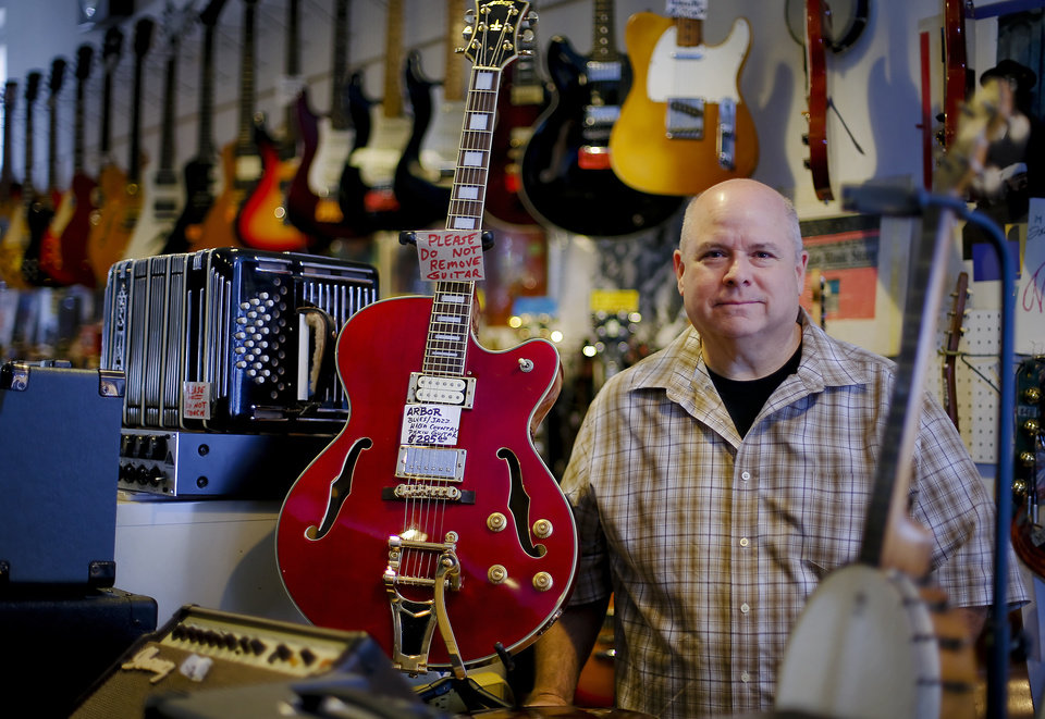 Photo - Horn Trader Music owner Scott Friedman at his store in Oklahoma City, Okla. Friday, July 13, 2012.   Photo by Chris Landsberger, The Oklahoman