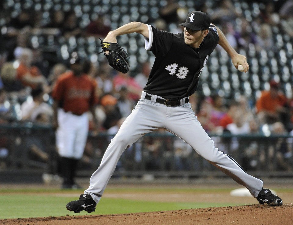 Chicago White Sox pitcher Chris Sale winds up during the first inning of an exhibition baseball game against the Houston Astros on Tuesday, April 3, 2012, in Houston. (AP Photo/Pat Sullivan)