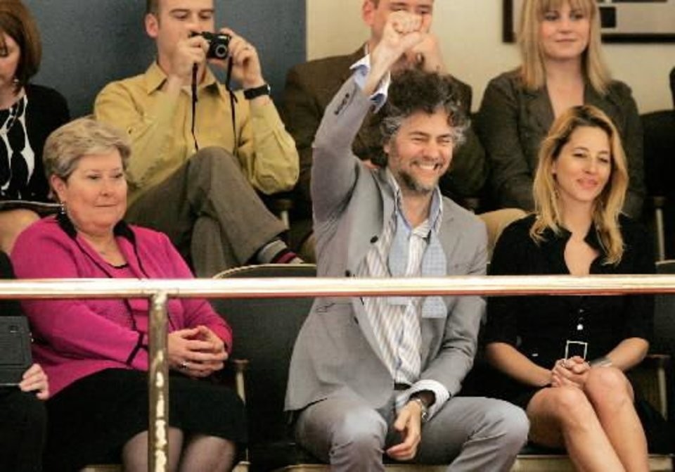 "Flaming  Lips front man Wayne Coyne celebrates Senate Joint Resolution 24 that names ""Do You Realize??"" by the  Flaming  Lips as the Official Oklahoma Rock song seated next to Coyne is Lt. Gov Jari Askins, left and his wife Michelle Martin-Coyne at the state Capitol in Oklahoma City, Oklahoma March 2, 2009. BY STEVE GOOCH"