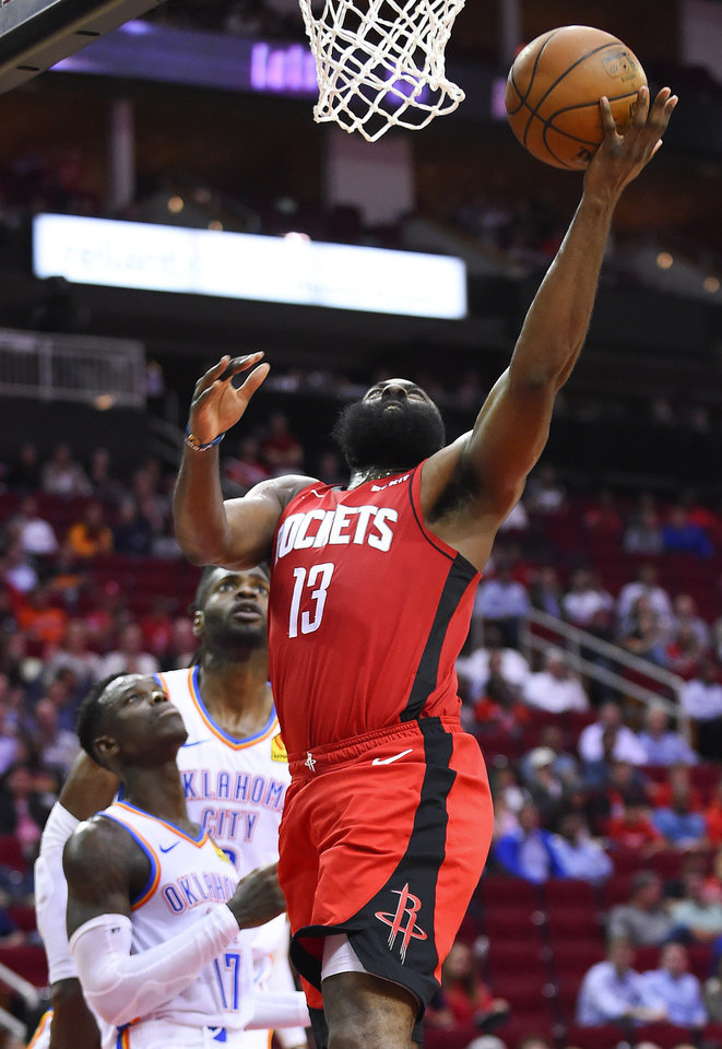 Photo - Houston Rockets guard James Harden (13) drives to the basket during the second half of an NBA basketball game against the Oklahoma City Thunder, Monday, Oct. 28, 2019, in Houston. (AP Photo/Eric Christian Smith)