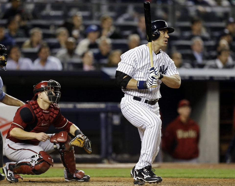 New York Yankees designated hitter Travis Hafner watches his eighth-inning solo home run in a baseball game against the Arizona Diamondbacks at Yankee Stadium in New York, Wednesday, April 17, 2013. (AP Photo/Kathy Willens)