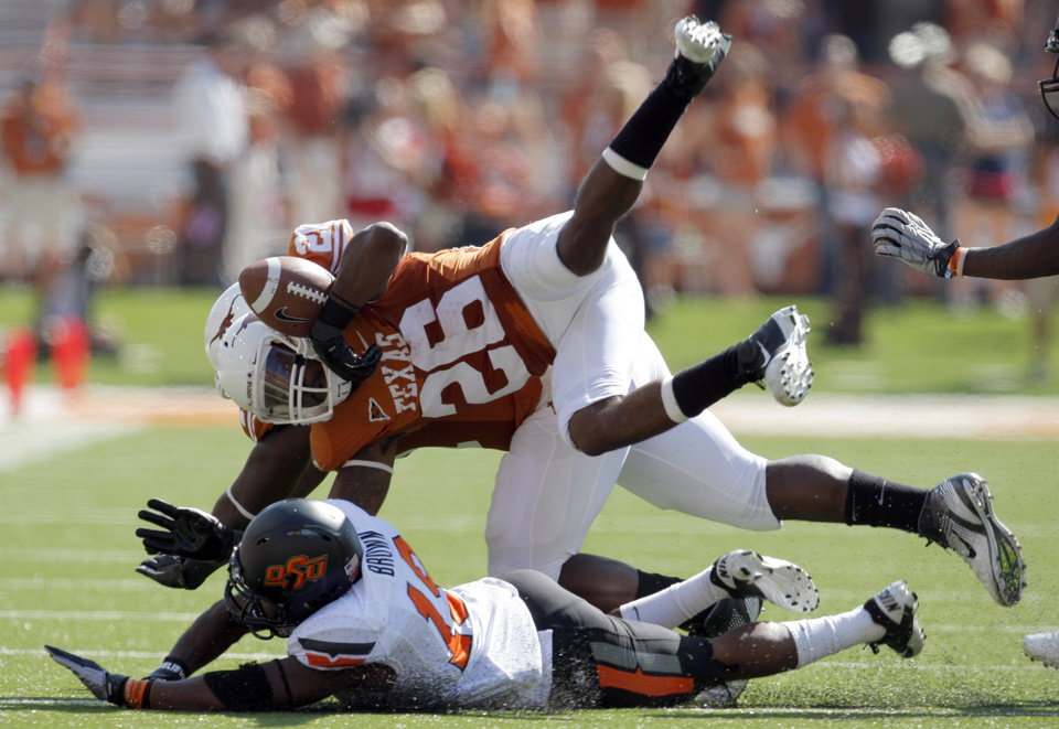 Photo - Oklahoma State's Brodrick Brown (19) tackles Texas' D.J. Monroe (26) during first half of a college football game between the Oklahoma State University Cowboys (OSU) and the University of Texas Longhorns (UT) at Darrell K Royal-Texas Memorial Stadium in Austin, Texas, Saturday, Oct. 15, 2011. Photo by Sarah Phipps, The Oklahoman