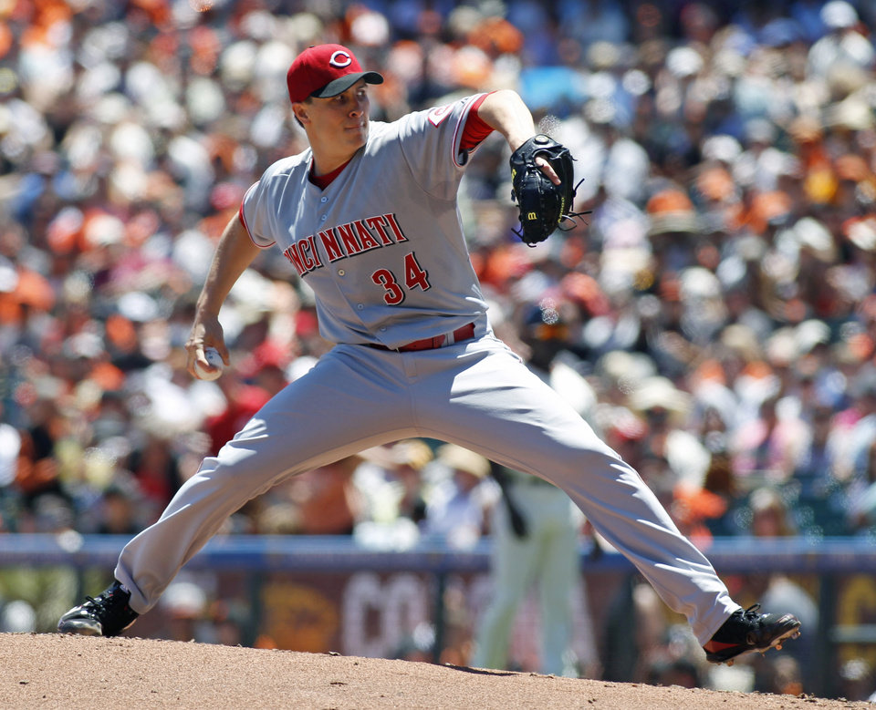 Photo - Cincinnati Reds pitcher Homer Bailey throws to the San Francisco Giants during the first inning of a baseball game, Sunday, June 29, 2014, in San Francisco. (AP Photo/George Nikitin)