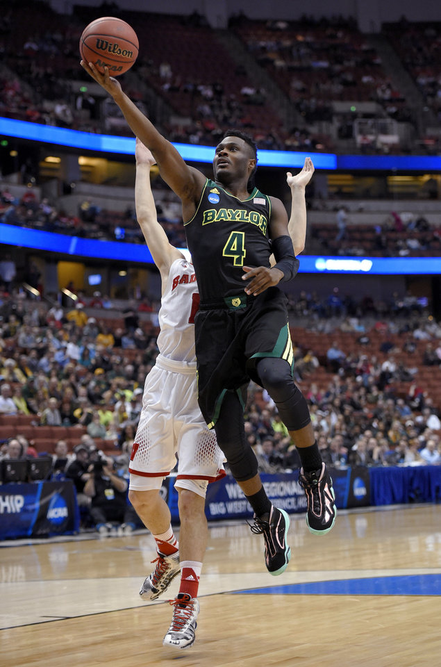 Photo - Baylor guard Gary Franklin (4) drives past Wisconsin guard Ben Brust during an NCAA men's college basketball tournament regional semifinal, Thursday, March 27, 2014, in Anaheim, Calif. (AP Photo/Mark J. Terrill)