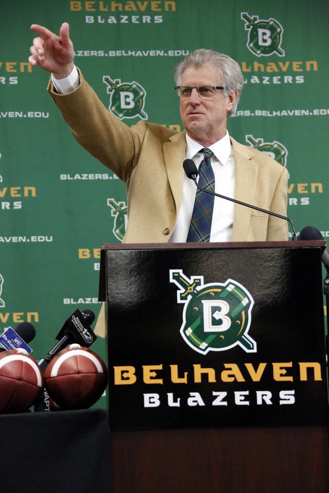Photo - New Belhaven University football coach Hal Mumme gestures towards friends as he speaks about his expectations as coach after he was introduced during an NAIA college football news conference in Jackson, Miss., Tuesday, Jan. 21, 2014. Mumme, a former head coach at a number of programs including Division 1 schools, Kentucky and New Mexico State University, most recently was passing game coordinator at SMU. (AP Photo/Rogelio V. Solis)
