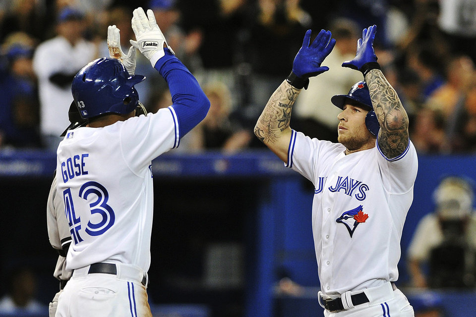 Photo -   Toronto Blue Jays' Brett Lawrie, right, celebrates a two-run home run with Anthony Gose against the New York Yankees during the third inning of a baseball game in Toronto, Thursday, Sept. 27, 2012. (AP Photo/The Canadian Press, Aaron Vincent Elkaim)