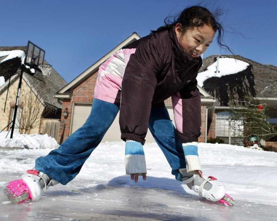 Kristin Dong, 8, makes tries out her roller skates on ice in her yard on Saturday, Dec. 26, 2009, in northwest Norman, Okla. Photo by Steve Sisney, The Oklahoman ORG XMIT: KOD