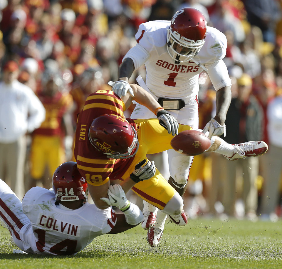 Photo - Oklahoma's Aaron Colvin (14) and Tony Jefferson (1) break up a pass intended for Iowa State's Josh Lenz (19) during a college football game between the University of Oklahoma (OU) and Iowa State University (ISU) at Jack Trice Stadium in Ames, Iowa, Saturday, Nov. 3, 2012. Oklahoma won 35-20. Photo by Bryan Terry, The Oklahoman