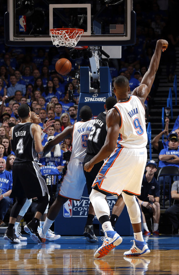 Photo - Oklahoma City's Serge Ibaka (9) watches his basket during Game 3 of the Western Conference Finals in the NBA playoffs between the Oklahoma City Thunder and the San Antonio Spurs at Chesapeake Energy Arena in Oklahoma City, Sunday, May 25, 2014. Photo by Bryan Terry, The Oklahoman