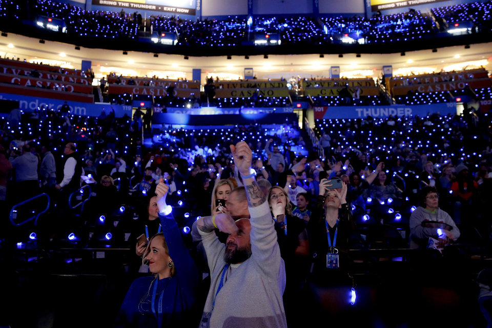 Photo - Fans cheer before an NBA basketball game between the Oklahoma City Thunder and the Dallas Mavericks at Chesapeake Energy Arena in Oklahoma City, Tuesday, Dec. 31, 2019. Oklahoma City won 106-101. [Bryan Terry/The Oklahoman]