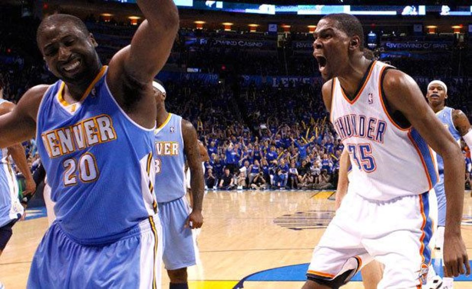 Photo - Oklahoma City's Kevin Durant (35) reacts after dunking the ball in front of Denver's Raymond Felton (20) during the first round NBA basketball playoff game between the Oklahoma City Thunder and the Denver Nuggets on  Wednesday, April 20, 2011, at the Oklahoma City Arena. Photo by Sarah Phipps, The Oklahoman