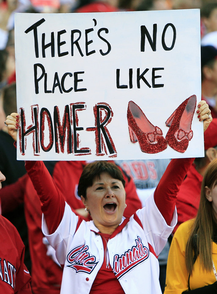 Photo -   A Cincinnati Reds fan holds a sign supporting starting pitcher Homer Bailey prior to Game 3 of the National League division baseball series against the San Francisco Giants, Tuesday, Oct. 9, 2012, in Cincinnati. (AP Photo/Al Behrman)