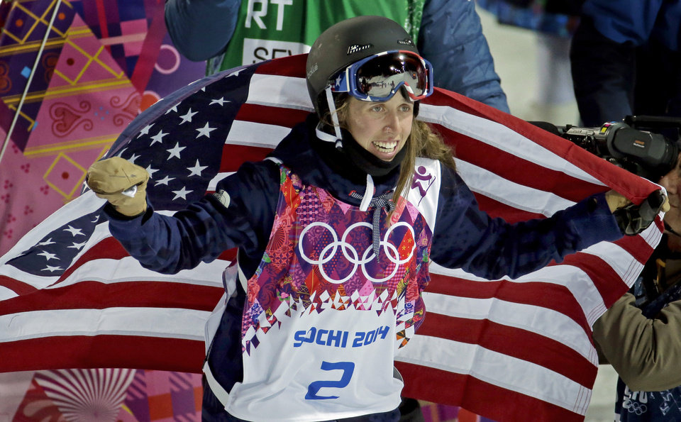Photo - Maddie Bowman of the United States celebrates her gold medal in the women's ski halfpipe at the Rosa Khutor Extreme Park, at the 2014 Winter Olympics, Thursday, Feb. 20, 2014, in Krasnaya Polyana, Russia. (AP Photo/Charlie Riedel)