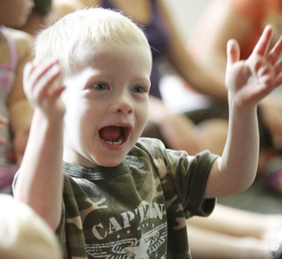 Rhythm Colwell, 3, shows his excitement during Lapsit: Playtime and Story Time at the Edmond Library on Tuesday. PHOTO BY PAUL HELLSTERN, THE OKLAHOMAN PAUL HELLSTERN