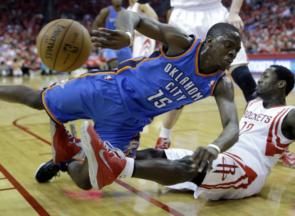 Oklahoma City Thunder\'s Reggie Jackson (15) falls onto Houston Rockets\' Patrick Beverley (12) during the first quarter of Game 4 in their first-round NBA basketball playoff series Monday, April 29, 2013, in Houston. (AP Photo/David J. Phillip)