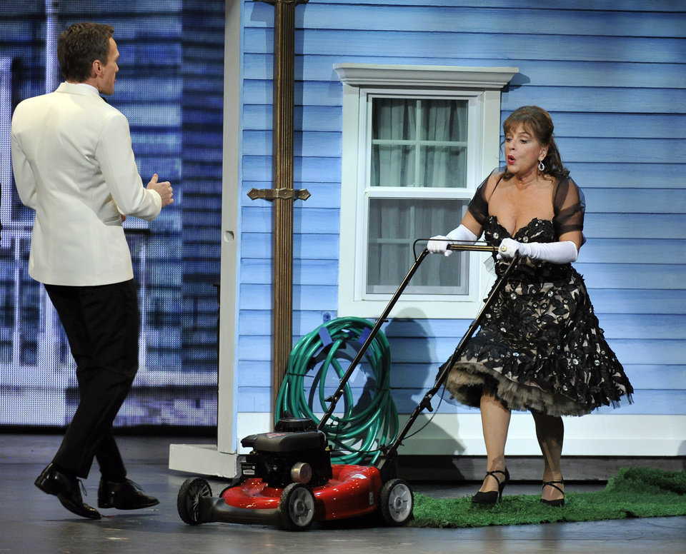 Photo -   Host Neil Patrick Harris, left, and Patti LuPone perform at the 66th Annual Tony Awards on Sunday June 10, 2012, in New York. (Photo by Charles Sykes /Invision/AP)