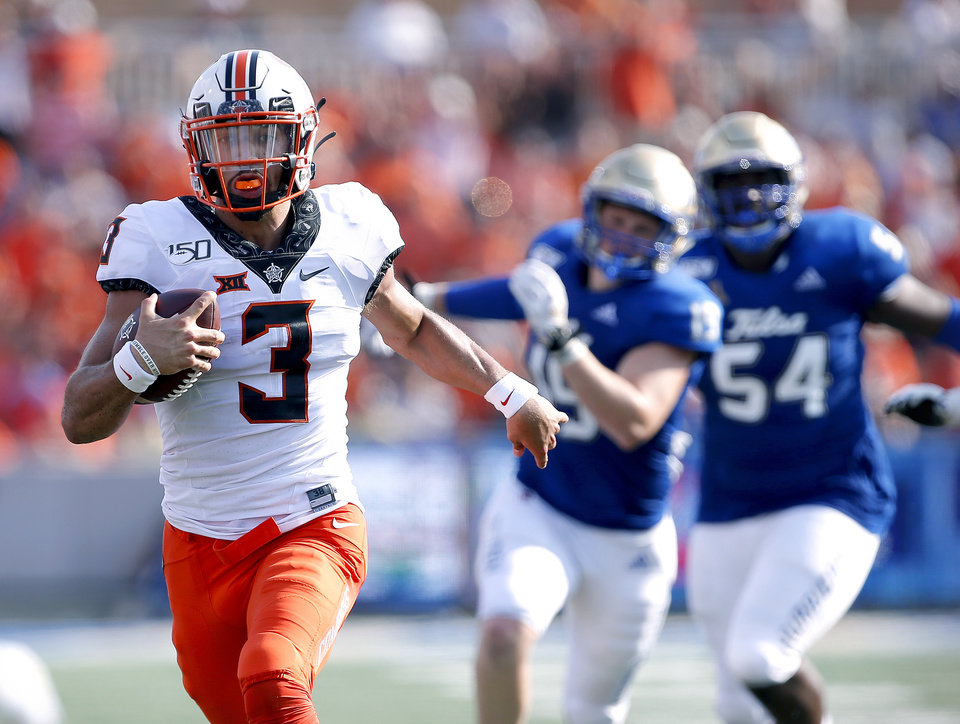 Photo - Oklahoma State's Spencer Sanders (3) rushes for a touchdown as Grant Sawyer (19) and Shemarr Robinson (54) chase him in the third quarter during a college football game between the Oklahoma State University Cowboys (OSU) and the University of Tulsa Golden Hurricane (TU) at H.A. Chapman Stadium in Tulsa, Okla., Saturday, Sept. 14, 2019. [Sarah Phipps/The Oklahoman]