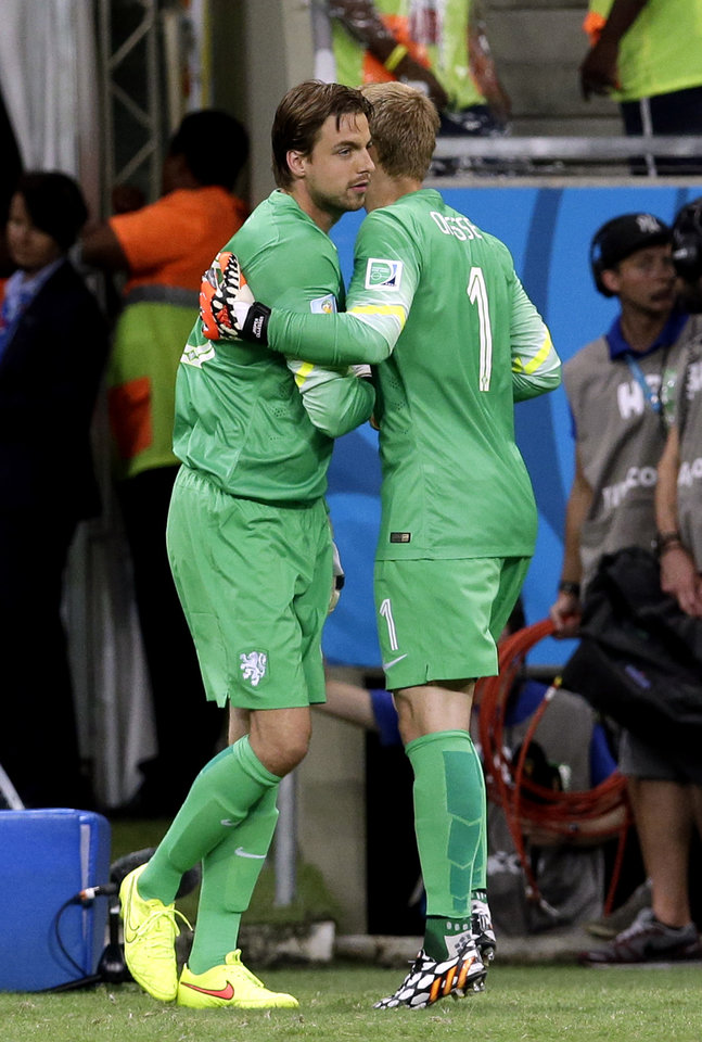 Photo - Netherlands' goalkeeper Tim Krul, left, replaces Netherlands' goalkeeper Jasper Cillessen during extra time of the World Cup quarterfinal soccer match between the Netherlands and Costa Rica at the Arena Fonte Nova in Salvador, Brazil, Saturday, July 5, 2014. (AP Photo/Hassan Ammar)