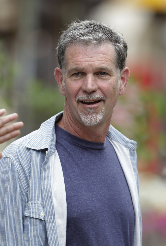 Photo -   In this July 11, 2012 photo, Netflix CEO Reed Hastings at the Allen & Company Sun Valley Conference in Sun Valley, Idaho. Netflix says its second-quarter earnings plunged 91 percent amid a slowdown in subscriber growth. The financial deterioration reported Tuesday follows a rare loss for Netflix during the opening three months of the year. In the latest quarter, Netflix Inc. added 1.1 million worldwide subscribers to its service that streams unlimited video over TVs and other Internet-connected devices for $8 per month. (AP Photo/Paul Sakuma)