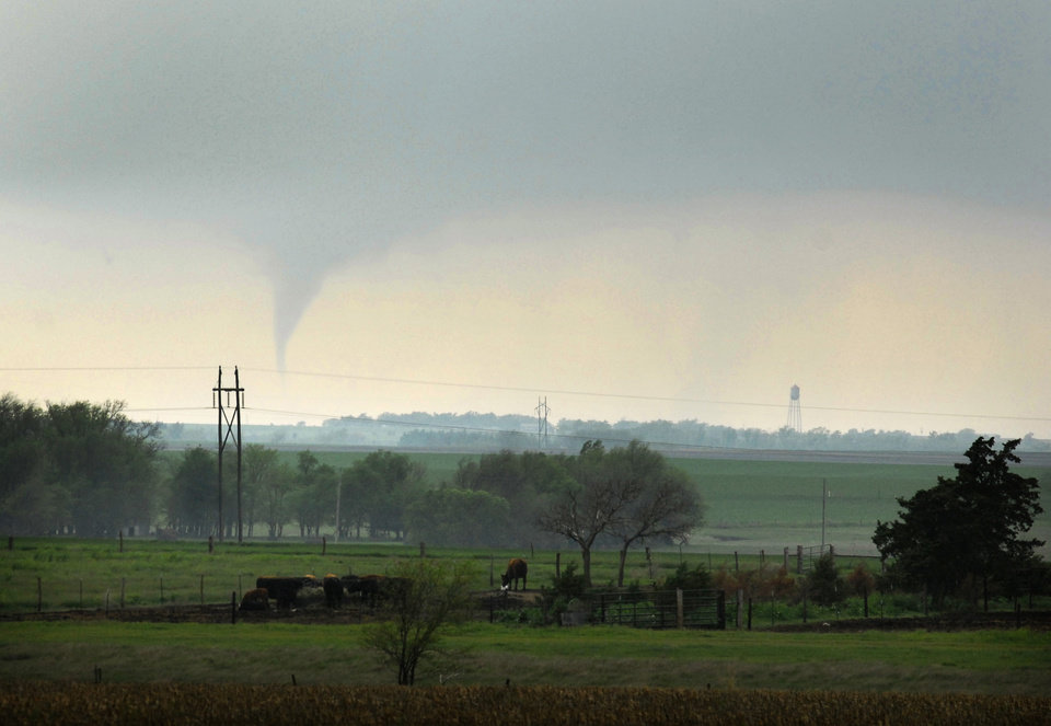 A funnel cloud dips down from the clouds on Saturday, April 14, 2012, just southwest of Otis, Kansas as severe thunderstorms roll across Kansas. The funnel touched down briefly before the storm weakened. Supercell thunderstorms spawned numerous tornadoes in Kansas on Saturday. (AP Photo/The Hays Daily News, Steven Hausler)