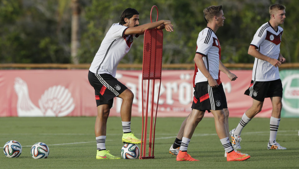 Photo - Germany's national soccer players Sami Khedira, from left, Erik Durm and Christoph Kramer attend a training session in Santo Andre near Porto Seguro, Brazil, Wednesday, June 18, 2014. Germany play in group G of the 2014 soccer World Cup. (AP Photo/Matthias Schrader)