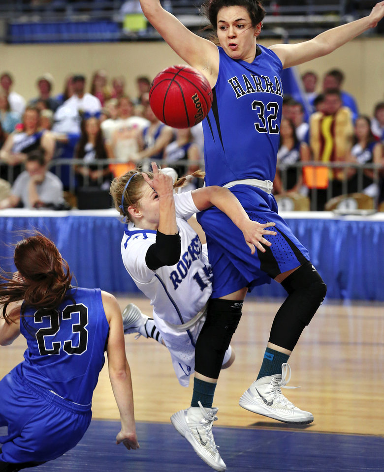 Photo - St. Mary  guard Jordan Hagood loses her footing and crashes to the floor when she tries to squeeze between Harrah players Maddison Collyer, left,  and Grace Brzozowski for a lay-up attempt in the first half of the Class 4A girls basketball quarterfinal game between Mount St. Mary and Harrah at Jim Norick Arena at State Fair Park  on Thursday night, Mar. 13, 2014. Photo by Jim Beckel, The Oklahoman