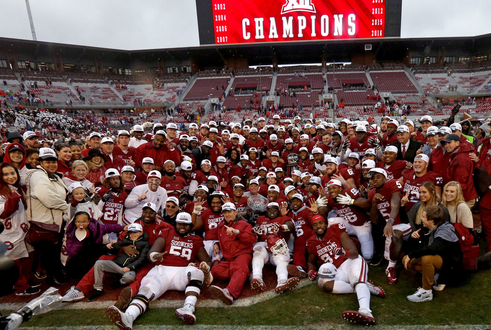 Photo - The Oklahoma team poses for a team photo after the Bedlam college football game between the Oklahoma Sooners (OU) and the Oklahoma State Cowboys (OSU) at Gaylord Family - Oklahoma Memorial Stadium in Norman, Okla., Saturday, Dec. 3, 2016. Oklahoma won 38-20.  Photo by Bryan Terry, The Oklahoman